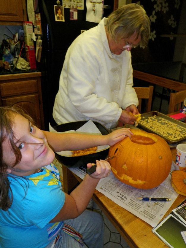 Pumpkin carving and seed roasting for Halloween