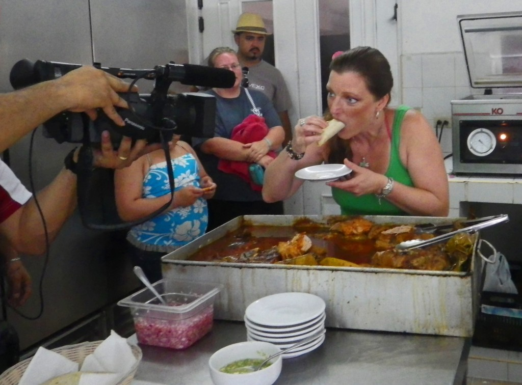Eating pork tacos in Akumal, Mexico with Chef Carlos and Shawna Coronado.