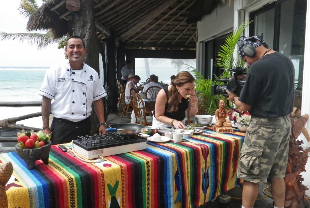 Chef Carlos with Shawna Coronado filming chicken empanadas.