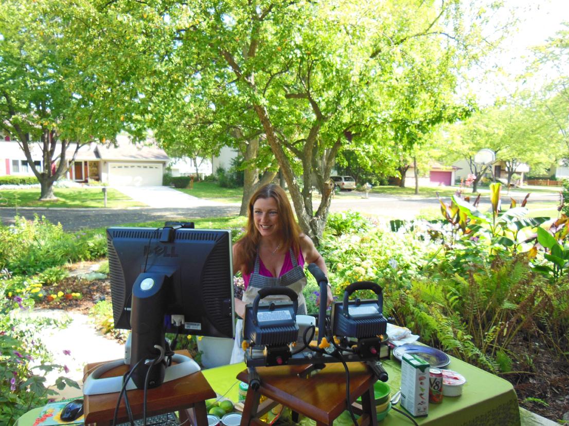 Shawna Coronado filming Google+ Hangouts at her front lawn veggie garden.