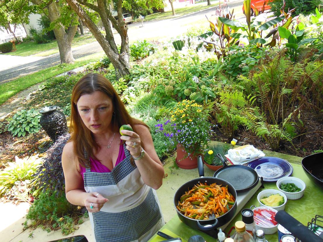 Shawna Coronado teaching front lawn vegetable garden culinary.