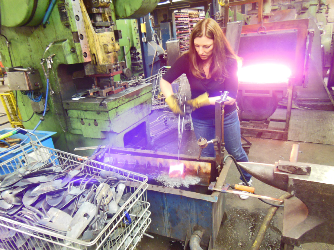 Shawna forging the DeWit Tool potting soil trowel.