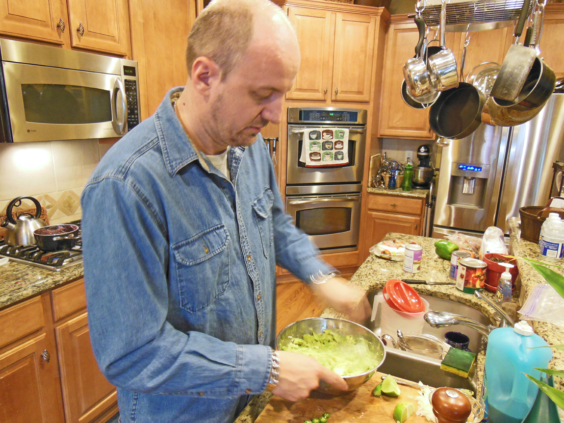 Michael Jenet cooking in his kitchen