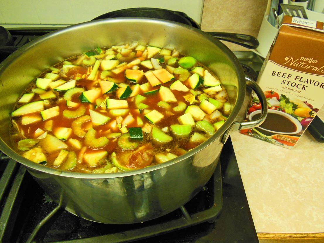 Beef vegetable soup simmering
