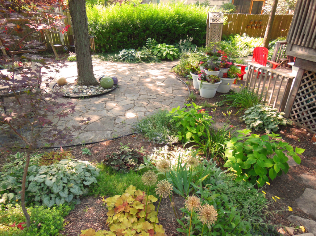 Back Flagstone Circle Garden with Container Towers