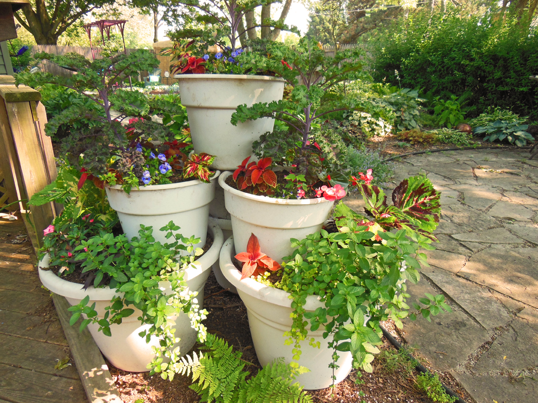 Container Garden Design plants add jungle feel to garden Container Garden Tower Pyramid Vegetables