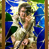 Saxon Holt, reflections in a garden - self-portait cracked
