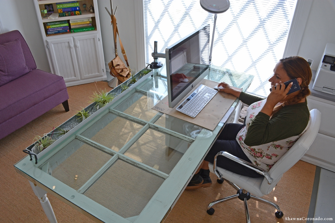 Shirley Bovshow Door Desk on phone