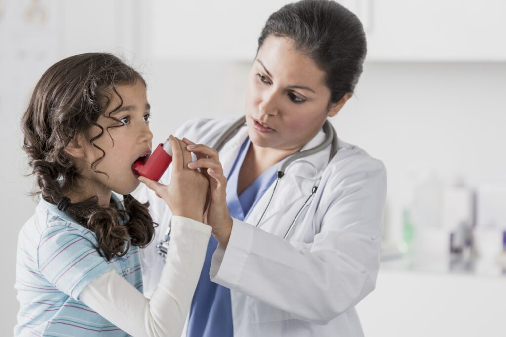 asthma inhaler with doctor and child