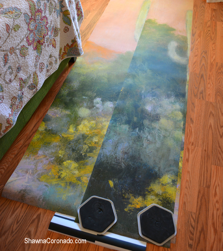 Wallpaper laid out on floor